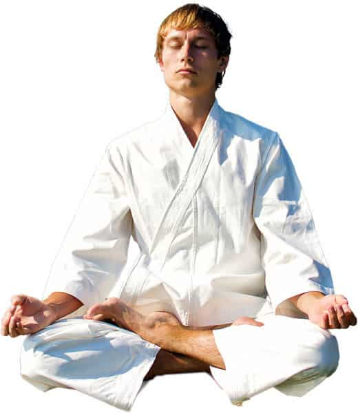 Martial Arts Lessons for Adults in Carrollton TX - Young Man Thinking and Meditating in White