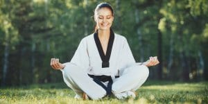 Martial Arts Lessons for Adults in Carrollton TX - Happy Woman Meditated Sitting Background